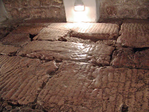 Photo: The floor of the chapel showing typical features of Roman pavements.