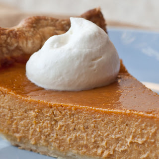Ultimate Pumpkin Pie with Rum Whipped Cream.