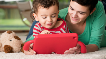 Woman and small child looking at tablet