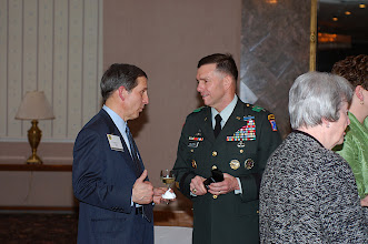 Photo: Lt. Gen. Caldwell spends time with USO President Sloan D. Gibson at the reception before the National Security Roundtable Dinner at Fort Leavenworth's Frontier Conference Center, March 16.