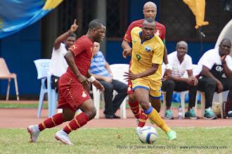 Photo: Jacques TUYISENGE (9) moves past Wakaso Mubarak (11) [Rwanda Vs Ghana AFCON2017 Qualifier, 5 Sep 2015 in Kigali, Rwanda.  Photo © Darren McKinstry 2015