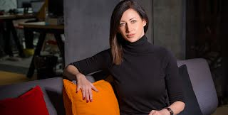 Founder Marija Ilic sits on a sofa facing the camera.