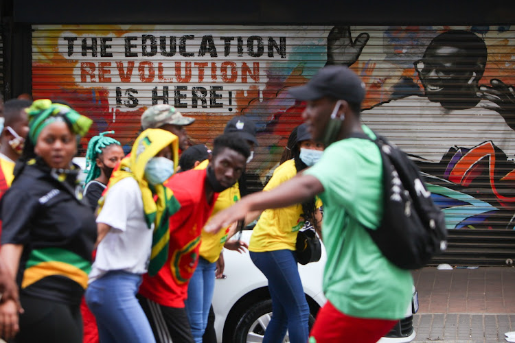 Students march through the streets singing struggle songs amid protests against the financial exclusion of students.