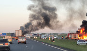 The N12, near the Etwatwa off-ramp, had to be closed to traffic after two trucks were set alight on Wednesday morning.