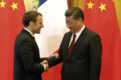 French President Emmanuel Macron and Chinese President Xi Jinping shake hands during their meeting at the Great Hall of the People in Beijing on January 9 2018. Picture: REUTERS