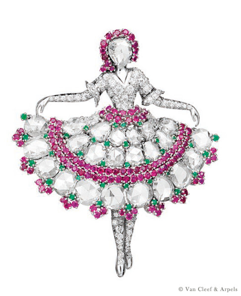 Photo: Ballerina clip depicting a dancer holding her skirt, platinum, diamonds, rubies and emeralds. Her face is represented by a rose-cut diamond crowned by rubies, 1943. Van Cleef & Arpels Collection