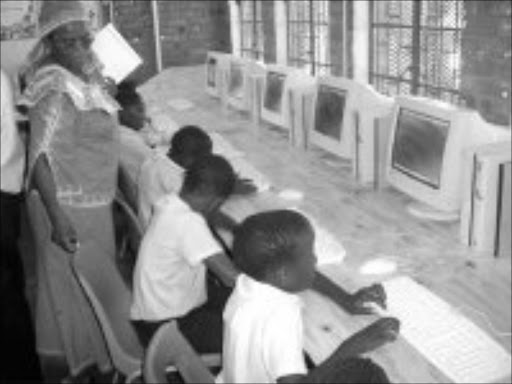 CONNECTED: Pupils at Mmushi Primary School in GaMatlala near Polokwane learn to operate the computers donated by a company in Limpopo. Pic. Moyahabo Mabeba. © Sowetan.