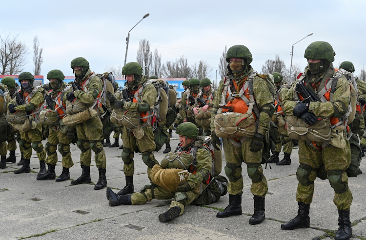 Service members of the Russian airborne forces get wait before boarding Ilyushin Il-76 transport planes during drills at a military aerodrome in the Azov Sea port of Taganrog, Russia April 22 2021. Picture: REUTERS/STRINGER