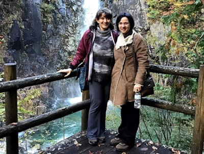 Dr Luiza de Sousa and post-doctoral fellow Dr Cathy Dzerefos at a waterfall in the Japanese alps.