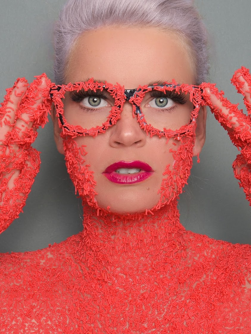 To create this shot, Christy Strever used condensed milk to stick Vermicelli cake sprinkles on to her skin.