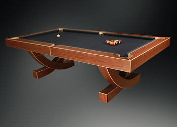 a pool table with wooden arched legs and dark blue felt