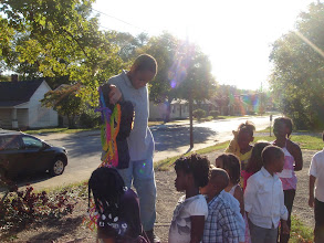Photo: the kids line up to pull the pinata strings. they lined up from youngest to oldest.