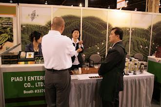 Photo: A customer talks to Yang Su and Tea Shen.