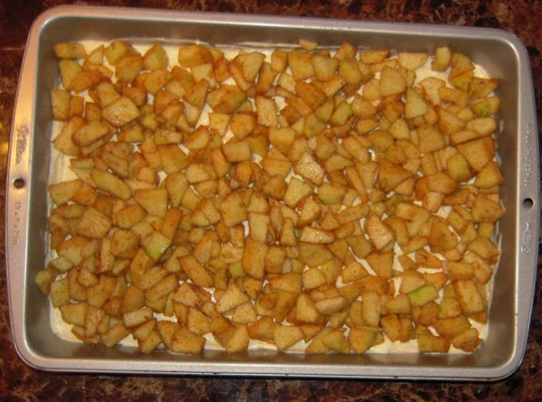 In a small bowl, stir together chopped apples, remaining 2 tablespoons sugar, cinnamon, and...