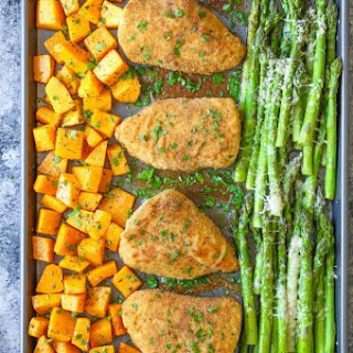 One Pan Baked Chicken with Butternut Squash and Parmesan Asparagus.