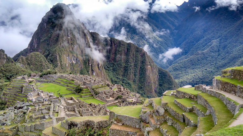 feature image for backpack peru travel guide which shows Machu Picchu the lost city of the incas near cusco in the andes mountains in peru south america