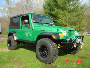 "Photo: 2"" Ome Lift and a 1.25 body lift with 33 BFG's A/T tires on 15x10 steel rims"