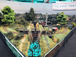 """Photo: 002 This shot of Pig Dyke Farm shows the sort of effects that the overhead green skylight was having on any horizontal surface that reflected, so although I have done as much """"creative"""" colour balancing and cropping as I have dared (I am not a fan of putting all sorts of cheats and loco steam etc in via photoshop), many of the shiny items such as water and locomotive cabs etc will still show green glints. Not an excuse for poor photos, just a whingeing abject waffle !"""