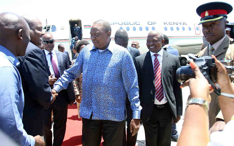 Kenyan President Uhuru Kenyata arrives at the East London Airport.