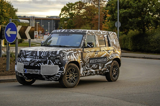 Disguised vehicle reveals the new Defender will have the iconic boxy shape.