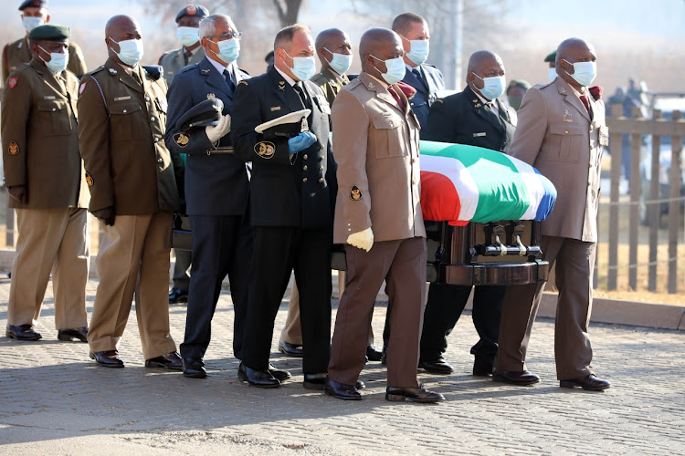Pallbearers arrive with the casket of Andrew Mlangeni during the official funeral held at UJ Soweto campus on July 29 2020.