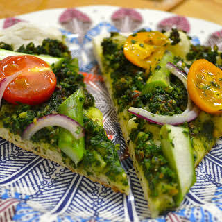 Kale Pesto Pizza With Fresh Asparagus + Heirloom Tomatoes.
