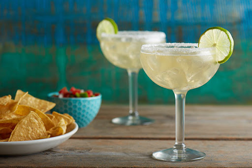 Enjoy margaritas or other festive drinks at Margaritaville at Sea on Norwegian Escape.
