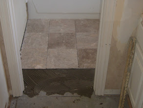 Photo: Marble 12X12 tile starting installation over becker board