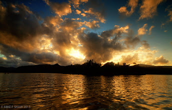 Photo: Liquid Gold  As the sky burns with sunset The lights glistens Upon the lake of liquid gold And the warmth fills my bones As the sight lifts my soul For here I will lay and rest With this vision to carry me off to dream  Lake Derwent in the lake District in the UK, one of the most beautiful places on earth.  Good morning :)