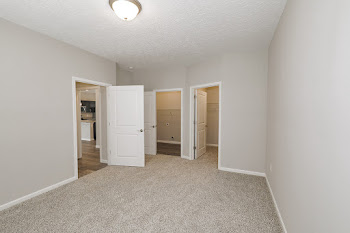 Dakota floorplan bedroom with neutral carpet and walk-in closet