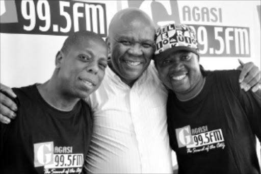 upbeat: New iGagasi FM DJ Vusi Letsoalo, station programme manager Patrick Bogatso and Archie Majola, also a new DJ at the station.Pic. THULI DLAMINI. 23/02/2010. © Sowetan.