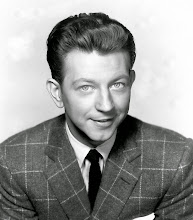 Photo: A more neutral portrait of O'Connor downplays the hair to focus on his light eyes.  The exquisite suit is the only nod to luxury. Note how toned-down this image is compared to those of female stars.