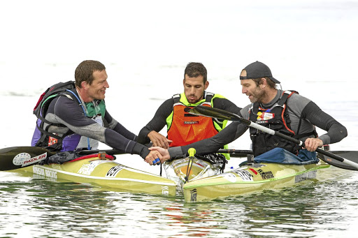 By hell or high water: Winner of the Berg River Canoe Marathon Adrián Boros, centre, flanked by runner-up Graeme Solomon, right, and third-placed Petr Mojzisek. Picture: JOHN HISHIN/GAMEPLAN MEDIA