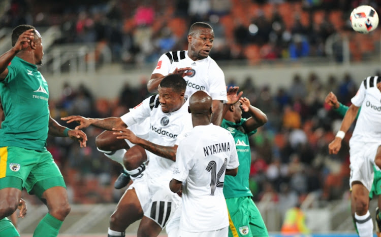 Ntsikelelo Nyauza of Orlando Pirates challenges for the ball during the Absa Premiership match against Baroka FC at Peter Mokaba Stadium on August 22, 2017 in Polokwane, South Africa.