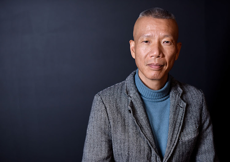 Cai Guo-Qiang' poses for a portrait during the WireImage Portrait Studio