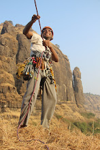 Photo: Ajit Bobhate belaying us up on TR as we got to the P1 ledge on day two. Mahuli Fort buttress is behind him with the detached Mahuli Baan pinnacle on the right; another target for another day. (Courtesy Ketan Vaidya)