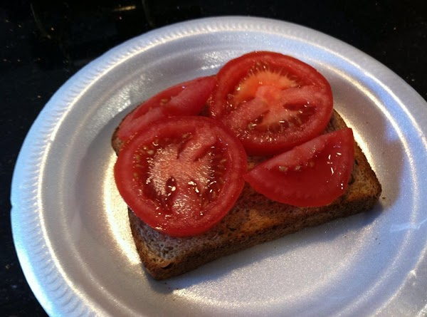 PLACE TOMATO SLICES ONTOP OF TOAST