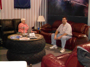 Photo: Brian Steed, of S&S Aviation at KFDW, gave a presentation on ADS/B earlier; Brian and Kathy Self now relax in the Berry/Foster lounge area
