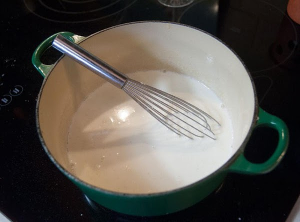 As soon as the flour and fat are incorporated, add the warm milk, in...