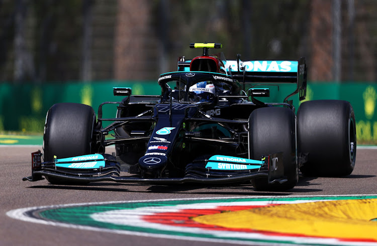 Valtteri Bottas of Finland driving the (77) Mercedes W12 on track during practice before the F1 Grand Prix of Emilia Romagna at Autodromo Enzo e Dino Ferrari on April 16 2021 in Imola, Italy.