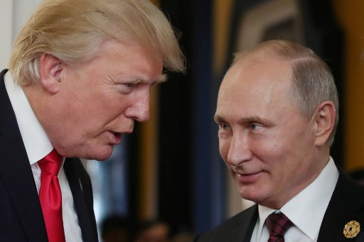 US President Donald Trump with Russia's President Vladimir Putin. Picture: REUTERS