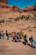 Photo: The group waiting for the steel ladder, with Corona Arch in the background (top)
