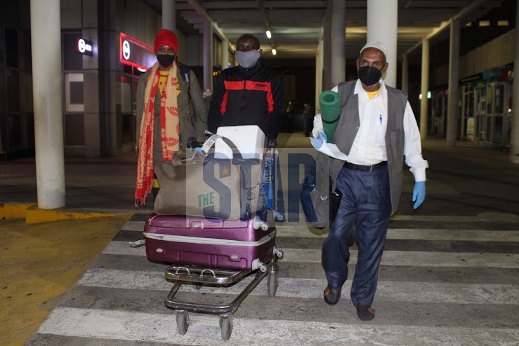 Kenyans who were stranded in India arrive at JKIA on May 7, 2020/ANDREW KASUKU
