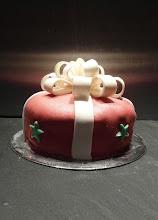Photo: Present shaped vanilla sponge cake decorated in fondant