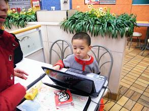 Photo: family gathered in KFC Tiedong franchise.