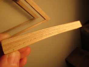 Photo: This is my redesign of the beams that broke, notice the diagonal seams in each layer between popsicle sticks. I did a similar diagonal sanding and splicing technique with the cross bracing since a singe popsicle stick is not long enough to laterally cross the bridge.