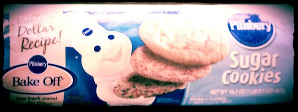 Preheat oven to temperature on refrigerator sugar cookie dough package.