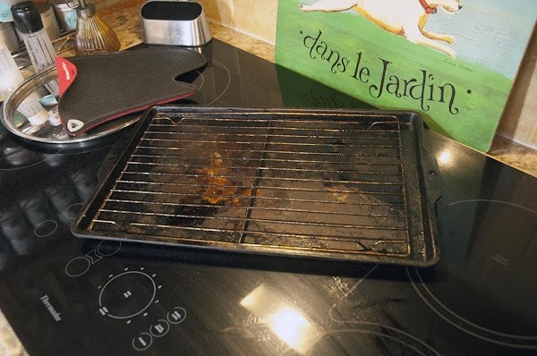 Place a rack inside of a rimmed baking sheet.