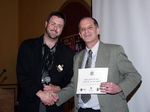 Photo: Tom O'Grady of Distech receives an ASHRAE Research Donation award
