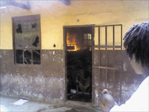 IN FLAMES: Pupils set two classrooms ablaze at Sebalamakgolo High School in Namakgale after the postponement of a trip to Polokwane. Pic: Alex Matlala. 03/03/2010. © Sowetan.